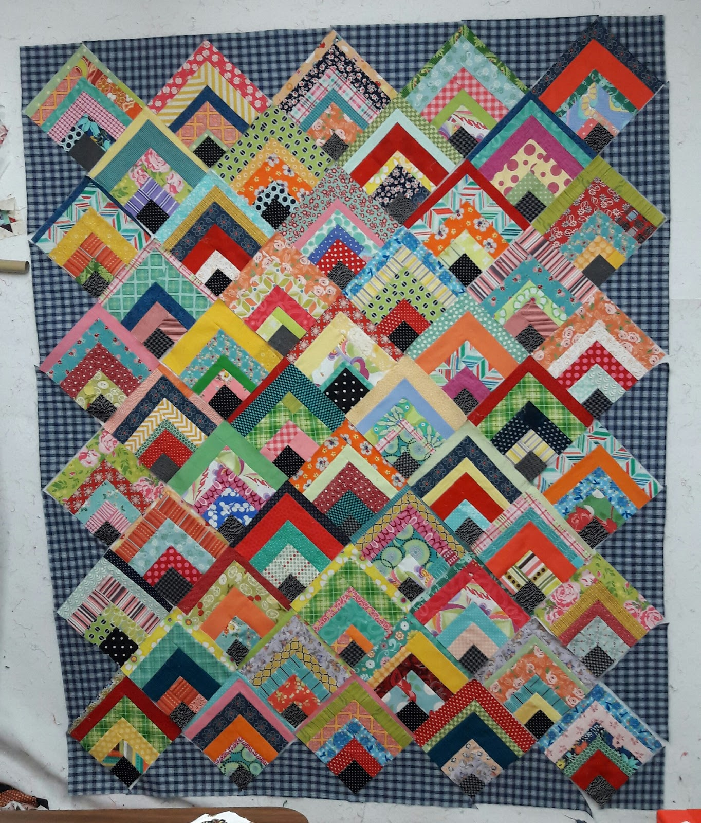 """Scrappy Quarter Log Cabin Quilt"" a Free Scrappy Quilt Pattern designed by Em from Aunt Em's Quilts"